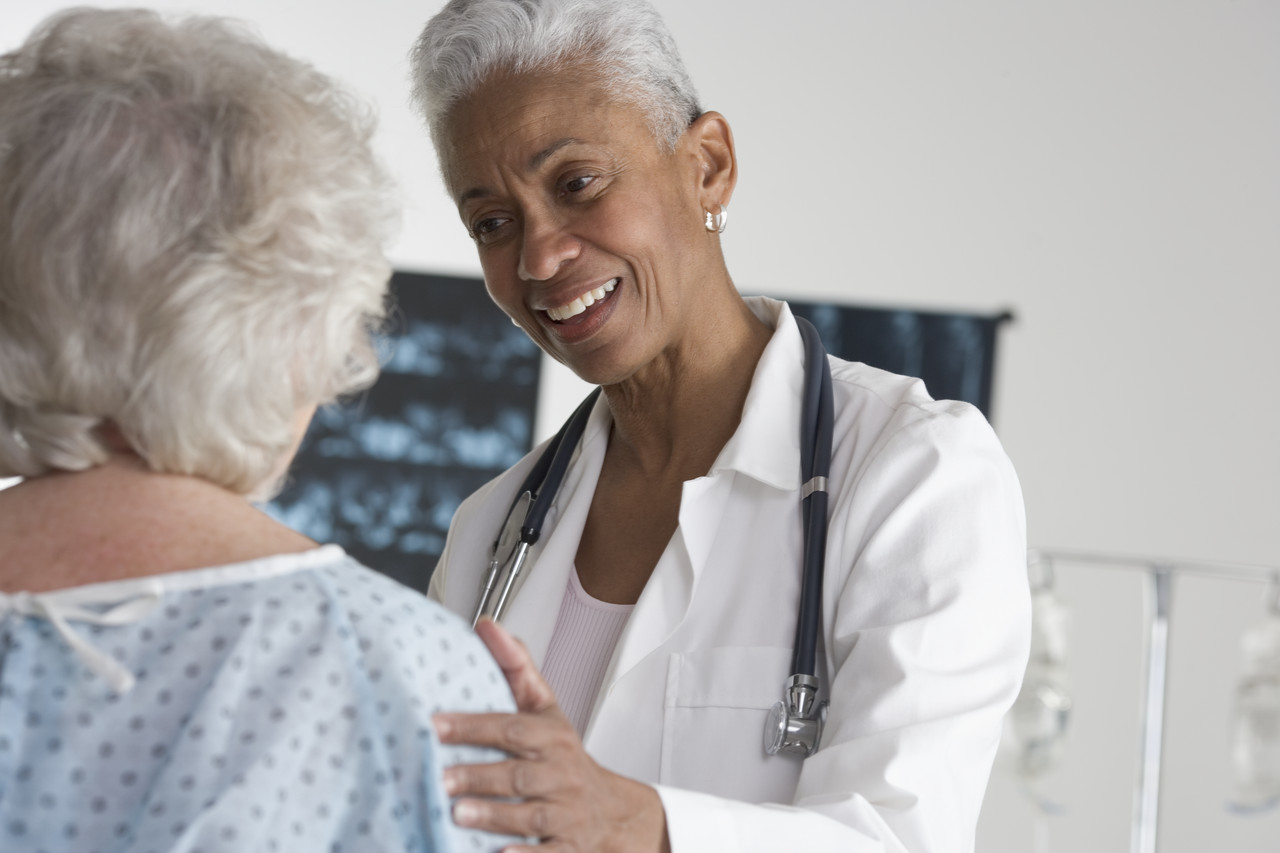 Doctor looking at elder patient